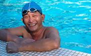older man swimming