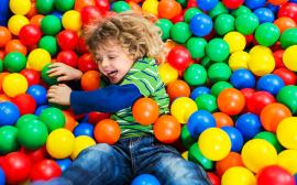 Child playing in ball pit