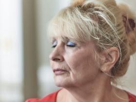 Mature woman eyes closed