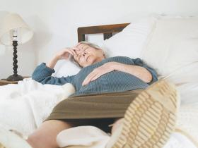 Senior woman bed sick headache