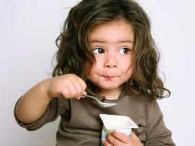 Child eating yoghurt