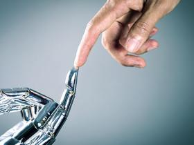 Bionic hand touching human hand