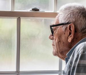 Man gazing out window