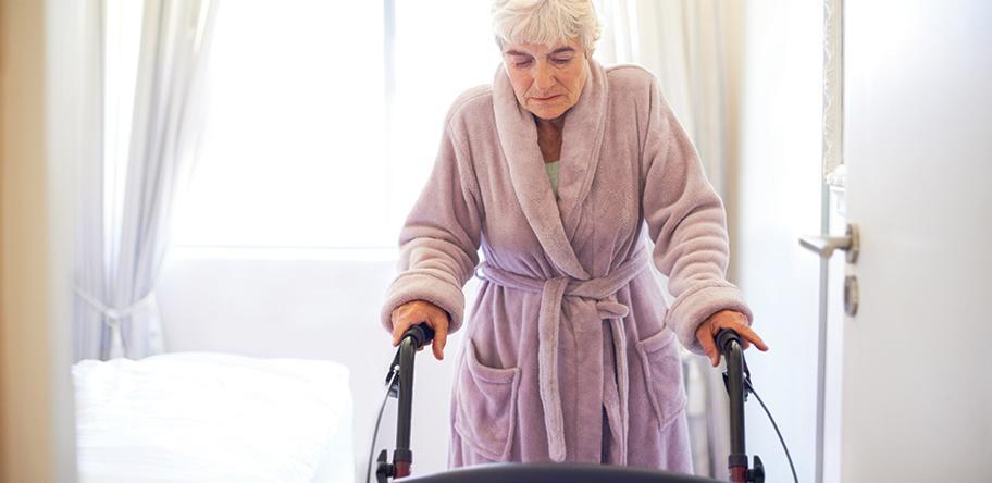senior woman mobility walker walking frame