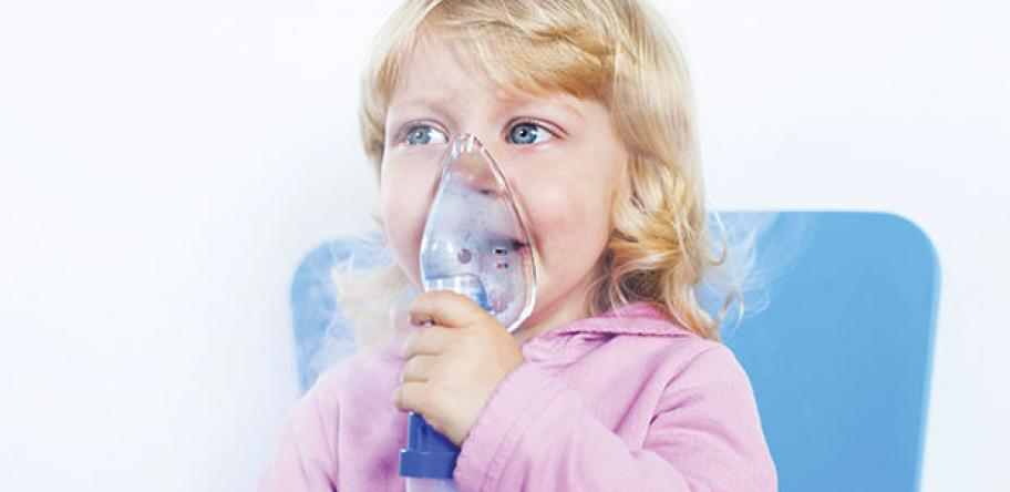 Child in oxygen mask