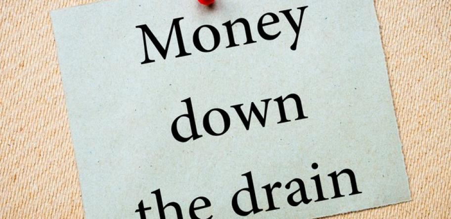 money down the drain sign